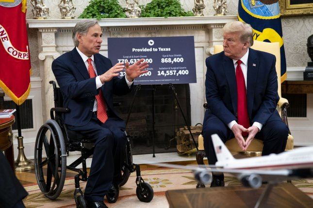 President Donald Trump meets with Texas Gov. Greg Abbott in the Oval Office on May 7. After months of phased reopenings, Abbott paused plans during an uptick in coronavirus cases in Texas. File Photo by Doug Mills/UPI