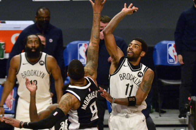 Brooklyn Nets guard Kyrie Irving (11), shown Feb. 21, 2021, has been sidelined since suffering a sprained ankle in Game 4 against the Milwaukee Bucks. File Photo by Jim Ruymen/UPI
