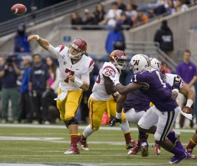 USC Trojans quarterback Matt Barkley passes against the Washington Huskies defense at CenturyLink Field in Seattle, Washington October 13 2012. Barkley completed10 of 20 passes for 167 yards, one touchdown and one interception in the 11th ranked Trojans win over the Huskies 24-14. UPI/Jim Bryant