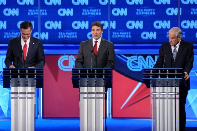 Republican candidates for president (L-R) former Mass. Gov. Mitt Romney; Texas Gov. Rick Perry; participate in the CNN/Tea Party Republican Debate in Tampa, Fla., Sept. 12, 2011. UPI/Christina Mendenhall
