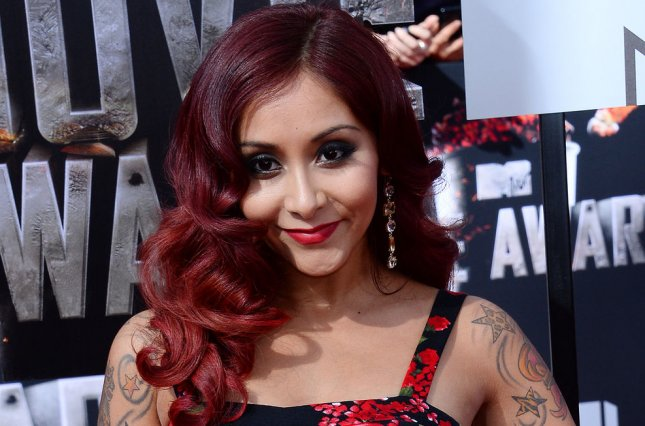47945a356f768 TV personality Nicole 'Snooki' Polizzi arrives for The MTV Movie Awards at  Nokia Theatre L.A. Live in Los Angeles, California on April 13, 2014.