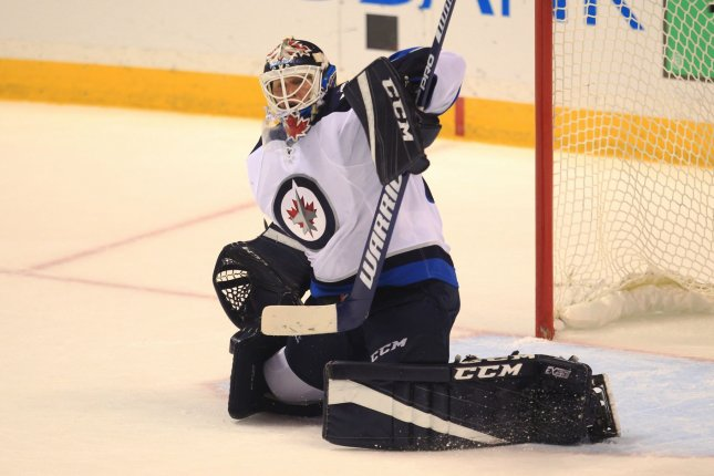 Goaltender Michael Hutchinson pulled off a 28-save performance as the Winnipeg Jets edged the Vancouver Canucks 2-1 on Sunday night in front of a jubilant home crowd. File Photo by Bill Greenblatt/UPI