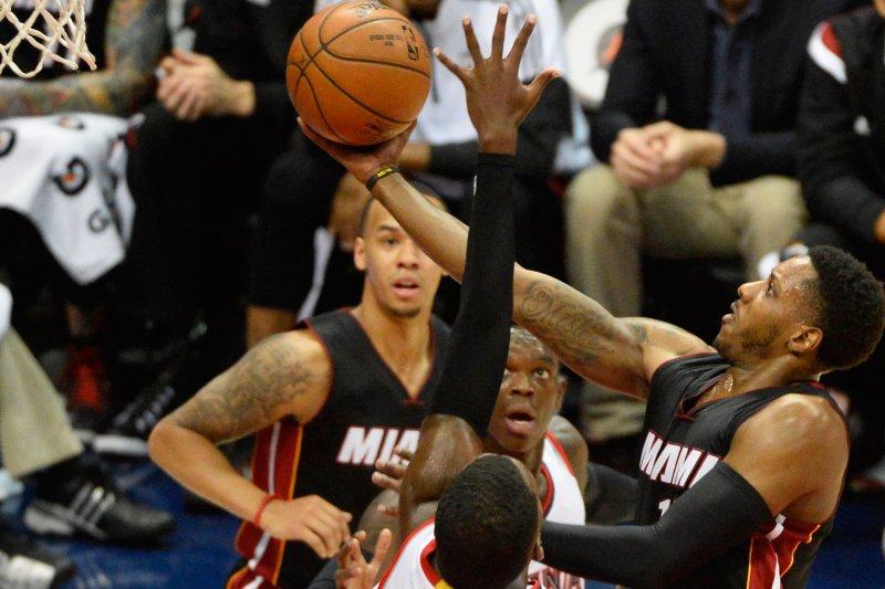 Former Miami Heat guard Mario Chalmers (R) shoots a layup. File photo by David Tulis/UPI