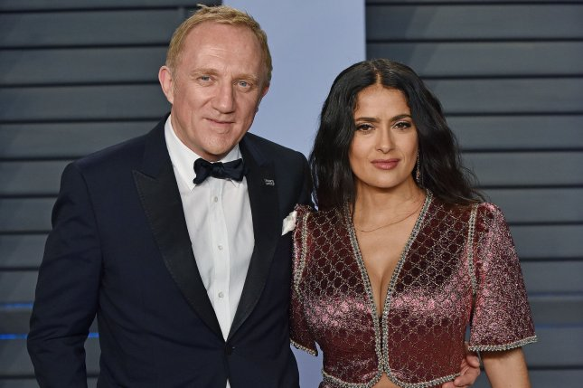 Salma Hayek (R) and her husband Francois-Henri Pinault. The couple renewed their vowels while on vacation. File Photo by Christine Chew/UPI