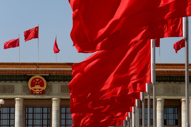 National flags fly outside the Great Hall of the People in Beijing. File Photo by Stephen Shaver/UPI