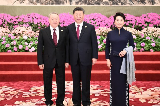 Kazakhstan President Nursultan Nazarbayev (L) poses for a photo with Chinese President Xi Jinping (C) and Xi's wife, Peng Liyuan, before a banquet during the Second Belt and Road Forum for International Cooperation in Beijing in April. File Pool Photo by Xie Huanchi/UPI