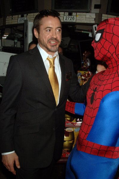 Actor Robert Downey Jr., who portrays Iron Man, trades words with someone dressed as Spider Man, another Marvel Comic character, as they meet on the trading floor of the New York Stock Exchange to promote Marvel Entertainment and Paramount pictures new film Iron Man, which stars Downey Jr., on April 29, 2008. (UPI Photo/Ezio Petersen)