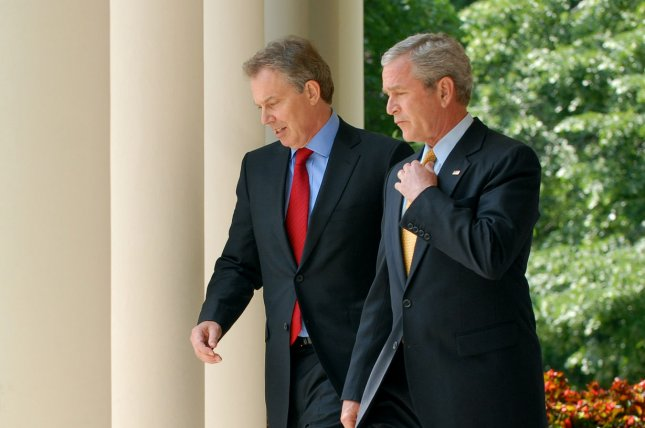 Former U.S. President George W. Bush (R) and former British Prime Minister Tony Blair walk through the colonnade to the Rose Garden of the White House on May 17, 2007. Blair's decision to follow the United States into the invasion of Iraq has been sharply criticized by a seven-year-long inquiry into the Iraq war. The Chilcot British Parliament inquiry concludes Britain entered the war without exhausting all peaceful options beforehand. File Photo by Roger L. Wollenberg