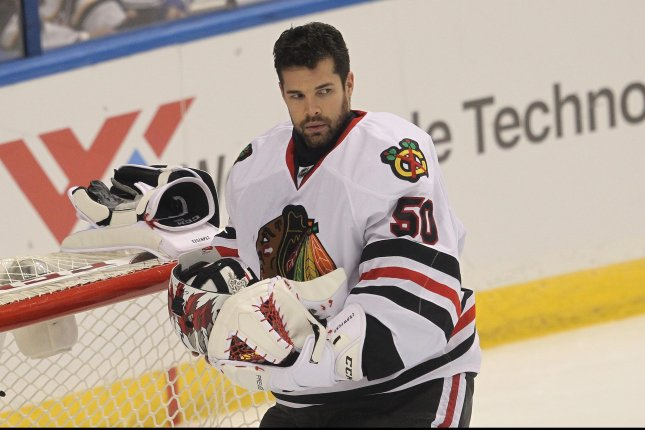 Chicago Blackhawks goaltender Corey Crawford adjusts his mask during a timeout against the St. Louis Blues in the first period at the Scottrade Center in St. Louis on November 9, 2016. Photo by Bill Greenblatt/UPI