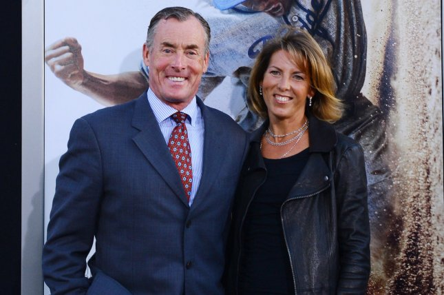 John C. McGinley, a cast member in the motion picture sport biography 42, attends the premiere of the film with his wife in Los Angeles on April 9, 2013. McGinley has begun work on Season 2 of Stan Against Evil. File Photo by Jim Ruymen/UPI