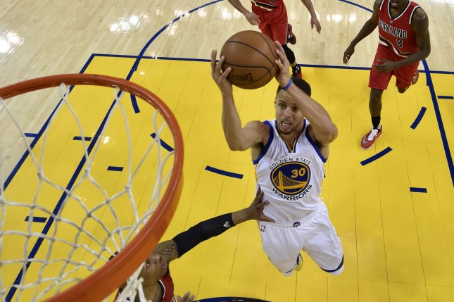 Golden State Warriors guard Stephen Curry (C) tossed a bounce alley-oop to himself just before the end of Sunday's All-Star Game. File Photo by John G. Mabanglo/UPI
