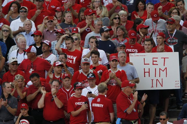 Cincinnati Reds fans hold up a sign asking for Major League Baseball commissioner Rob Manfred to reinstate franchise icon Pete Rose, enabling him access to the Hall of Fame. Rose is banned from the sport for life after betting on the game. File Photo by John Sommers II/UPI