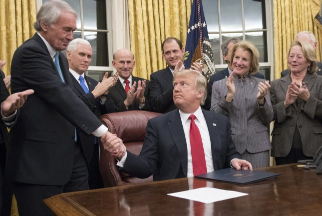 President Donald Trump signs the Interdict Act -- a law to stop the flow of opioids into the United States -- in the Oval Office of the White House on January 10, 2018. File Photo by Ron Sachs/UPI