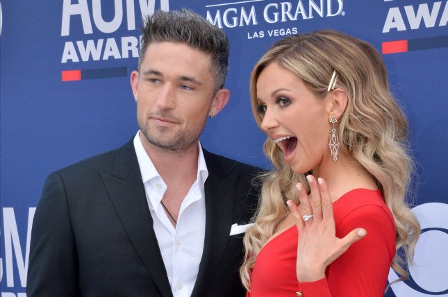 Carly Pearce (R) and Michael Ray married at a whimsical wedding Sunday in Nashville, Tenn. File Photo by Jim Ruymen/UPI