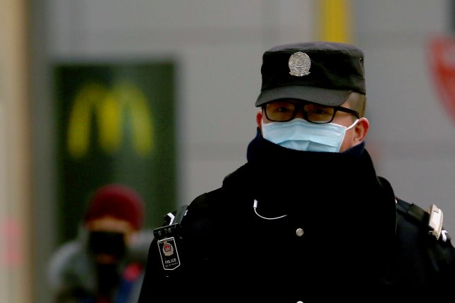 Chinese police monitor the streets at a popular shopping area as the coronavirus has become a threat to Beijing on Monday. Photo by Stephen Shaver/UPI