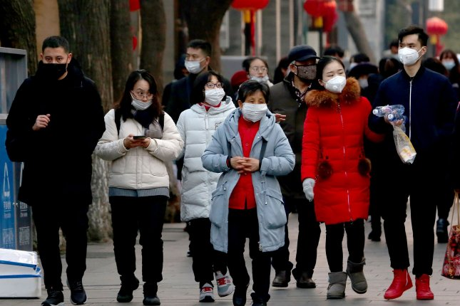 People in China wear protective respiratory masks in Beijing on Saturday, January 25, 2020. New analysis suggests far more people have been infected with 2019-nCoV than reported because some are asymptomatic and others may not seek medical attention. Photo by Stephen Shaver/UPI