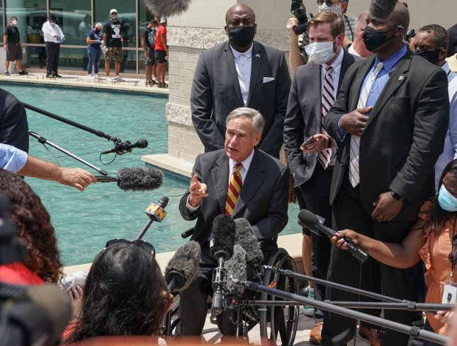 Texas Gov. Greg Abbott last month ordered state troopers to pull over drivers transporting migrants who suspected of carrying COVID-19. File Photo by Jemal Countess/UPI