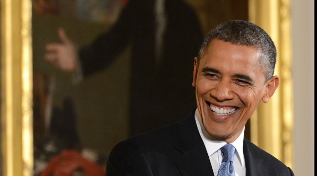 President Barack Obama, Time's Person of the Year, shares a light moment during a press conference in the East Room of the White House on November 14, 2012 in Washington, DC. UPI/Pat Benic