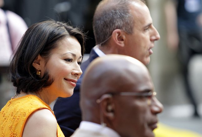 Ann Curry stands with Matt Lauer and Al Roker before Kenny Chesney performs on the NBC Today Show at Rockefeller Center in New York City on June 22, 2012. UPI/John Angelillo