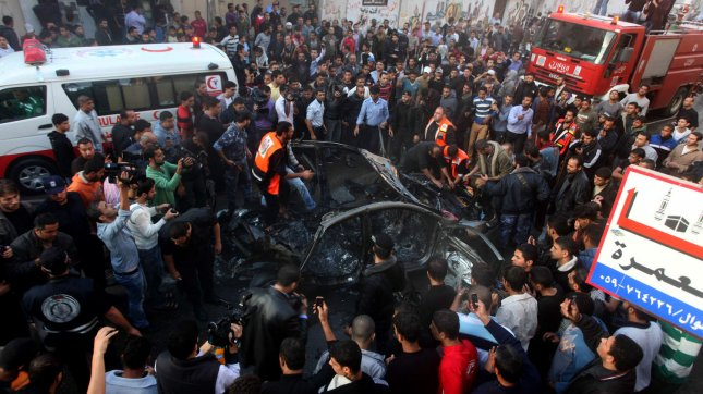 Palestinian firefighters extinguish fire from the car of Ahmad Jaabari, head of the military wing of the Hamas movement, the Ezzedin Qassam Brigades, after it was hit by an Israeli air strike in Gaza City on November 14, 2012 Israel killed the military commander of the Islamist group Hamas in a missile strike on the Gaza Strip on Wednesday and launched air raids across the enclave, pushing the two sides to the brink of a new war. Hamas said Ahmed Al-Jaabari, who ran the organisation's armed wing, Izz el-Deen Al-Qassam, died along with an unnamed associate when their car was blown apart by an Israeli missile. Palestinians said nine people were killed, including a seven-year-old girl. UPI/Ashraf Mohammad