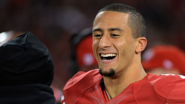 San Francisco 49ers QB Colin Kaepernick (7) laughs on the sidelines in the fourth quarter of the NFC Divisional Playoff at Candlestick Park in San Francisco on January 12, 2013. Kaepernick ran for 181 yards and two touchdowns as the 49ers defeated the Packers 45-31. UPI/Terry Schmitt