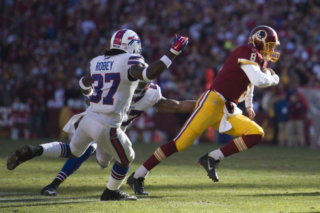 Washington Redskins quarterback Kirk Cousins (8) rushes for a touchdown against the Buffalo Bills in the second quarter at FedEx Field in Landover, Maryland on December 20, 2015. Photo by Kevin Dietsch/UPI