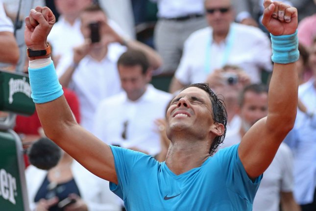 Rafael Nadal of Spain celebrates after winning his French Open men's final match against Dominic Thiem of Austria on Sunday at Roland Garros in Paris. Photo by David Silpa/UPI