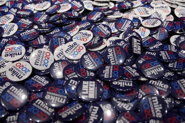 Campaign buttons for Democratic presidential candidate Michael Bloomberg are seen on a table in New York City before a Women for Mike event on January 15. File Photo by John Angelillo/UPI