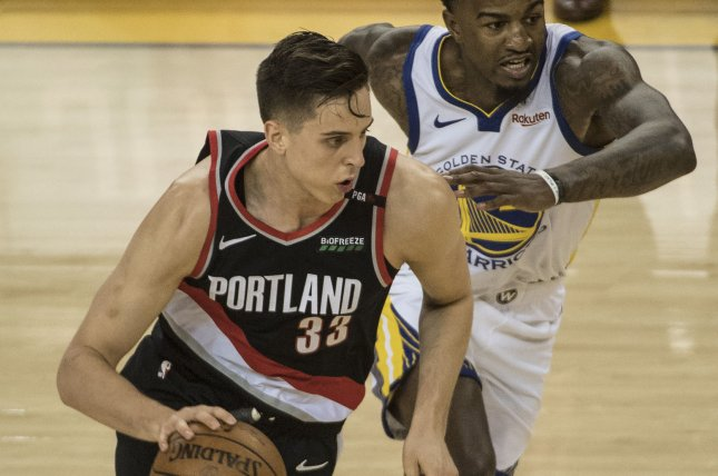 Portland Trail Blazers forward Zach Collins (33) has a hairline medial malleolus stress fracture in his left ankle, which will require season-ending surgery. File Photo by Terry Schmitt/UPI