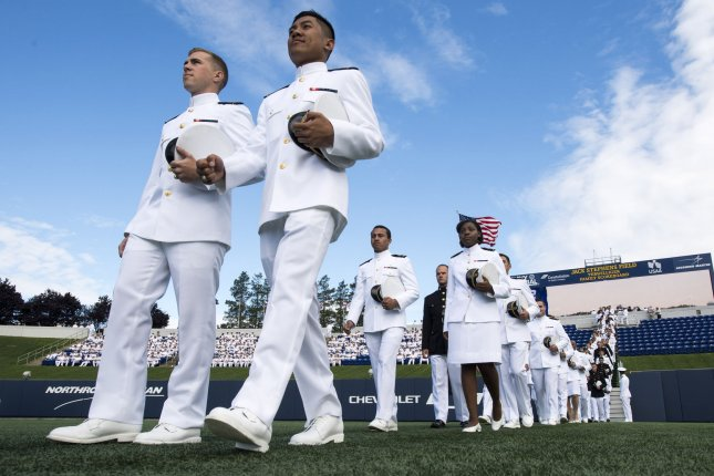 Graduating midshipmen arrive for the graduation and commissioning ceremony at the U.S. Naval Academy in Annapolis, Md. on May 26, 2017. On July 26, 1948, President Harry S. Truman ordered desegregation of the U.S. military. File Photo by Kevin Dietsch/UPI