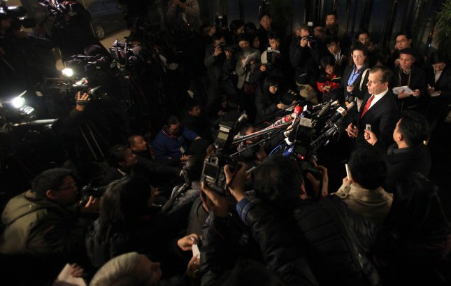 U.S. Special Representative for North Korea Policy Glyn Davies (R) speaks to the media during an impromptu press conference at a hotel in Beijing, February 23, 2012. Davies met with North Korean officials to discuss Pyongyang's nuclear program, the first such talks since the death of the longtime leader Kim Jong Il. UPI/Stephen Shaver