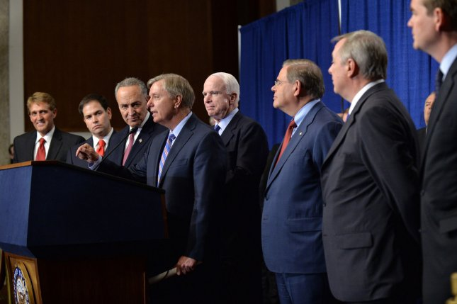 The Gang of Eight From left to right, Sen. Jeff Flake (R-AZ), Sen. Marco Rubio (R-FL), Sen. Charles Schumer (D-NY), Sen. Lindery Graham (R-SC), Sen. John McCain (R-AZ), Sen. Robert Menendez (D-NJ), Assistant Majority Leader Richard Durbin (D-IL) and and Sen. Michael Bennet (R-CO) crossed the political divide to come up with immigration reform. file photo. UPI/Kevin Dietsch