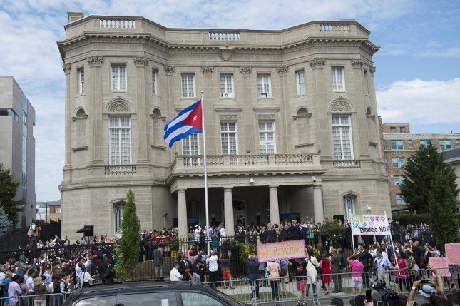 A Cuban flag is raised over during a ceremony to reopen the Cuban embassy to the United States, in Washington, D.C. on July 20, 2015. After 54 years Cuba's embassy has reopened today as part of President Obama's plan to restart diplomatic relations with the island nation. Photo by Kevin Dietsch/UPI