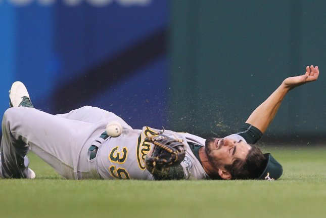 Oakland Athletics right fielder Brett Eibner can't come up with a fly ball off the bat of St. Louis Cardinals Jedd Gyorko in the third inning at Busch Stadium in St. Louis. The play was ruled a single for Gyorko. Photo by Bill Greenblatt/UPI