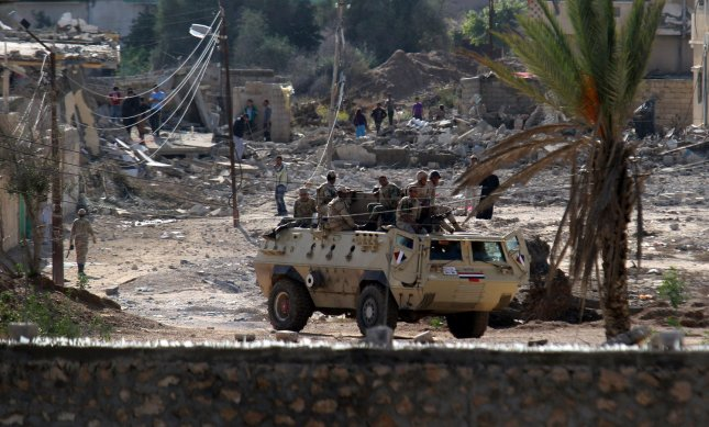 The Egyptian Army announced Thursday that 10 soldiers died when their two vehicles struck improvised explosive devices in the Sinai Peninsula. The vehicles were pursuing Islamist insurgents during a raid on a Sinai hideout. File Photo by Ismael Mohamad/UPI
