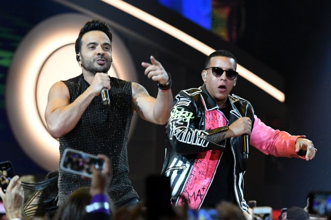 Luis Fonsi (L) and Daddy Yankee perform at the Billboard Latin Music Awards on April 27. The singers' hit Despacito passed 4.6 billion plays this week. File Photo by Gary I. Rothstein/UPI