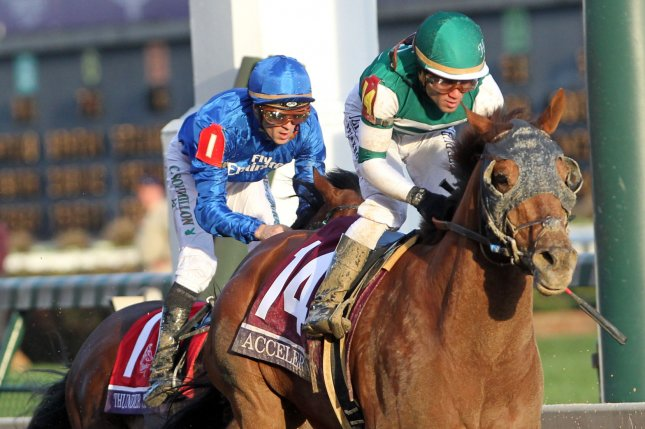 Jockey Joel Rosario rides Accelerate to victory in the 2018 Breeders' Cup Classic Championship race at Churchill Downs in Louisville, Kentucky on November 3, 2018. Photo by John Sommers II/UPI