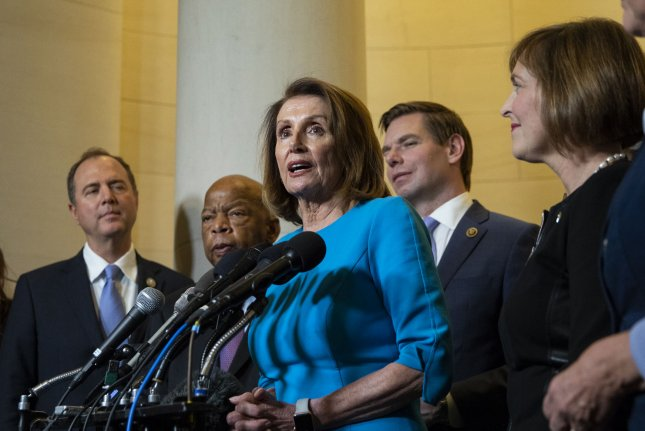 House Democratic Leader Nancy Pelosi, D-Calif., speaks with reporters after a Democratic caucus meeting at the Capitol in Washington, D.C. on Wednesday. Photo by Alex Edelman/UPI