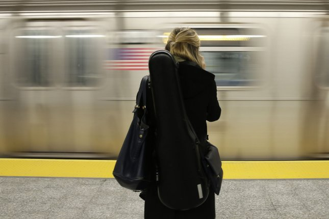 A woman waits for a train at the 86th Street Second Avenue Subway station on January 5, 2017 in New York City. Photo by John Angelillo/UPI