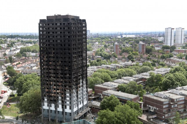 Grenfell Tower inquiry member resigns over links to cladding firm