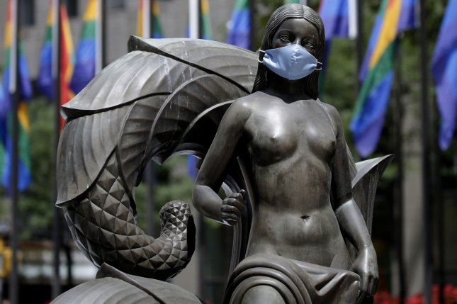 The Mankind Figures statues at New York City's Rockefeller Center wear a protective face mask. Face coverings, handwashing and social distancing can cut spread of COVID-19 by 50%, a new study has found. Photo by John Angelillo/UPI
