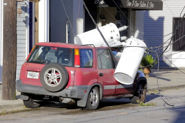 Electrical transformers from a utility pole are seen toppled onto a vehicle in uptown New Orleans, La., on Thursday, one day after Hurricane Zeta passed through the area. Photo by AJ Sisco/UPI