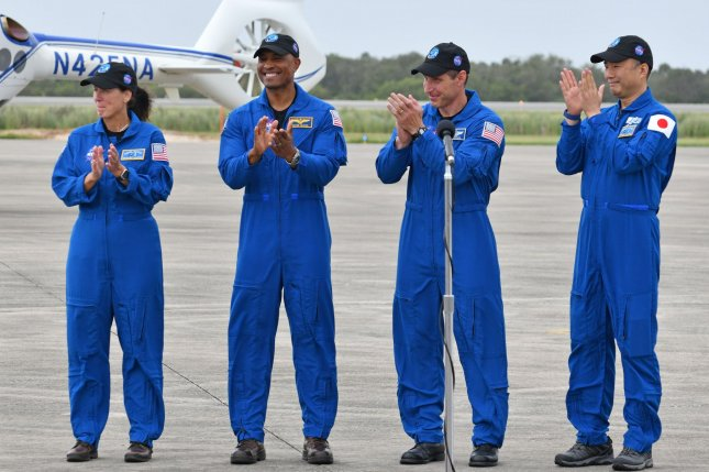 NASA astronauts for the the Crew 1 trip to the International Space Station are mission specialist Shannon Walker (L to R), pilot Victor Glover and commander Michael Hopkins, along with Japan Aerospace Exploration Agency mission specialist, Soichi Noguchi, speak after they arrive at Kennedy Space Center in Florida on Sunday. Photo by Joe Marino/UPI