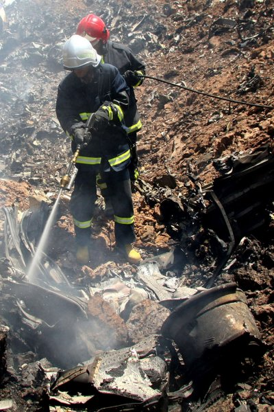 Iranian fire fighters search at the site where a Russian-made Tupolev plane crashed near the city of Qazvin, about 150 km (93 miles) north of Tehran, Iran on July 15, 2009. All 168 passengers on board the plane were killed. (UPI Photo/Erfan Dadkhah/IRNA)