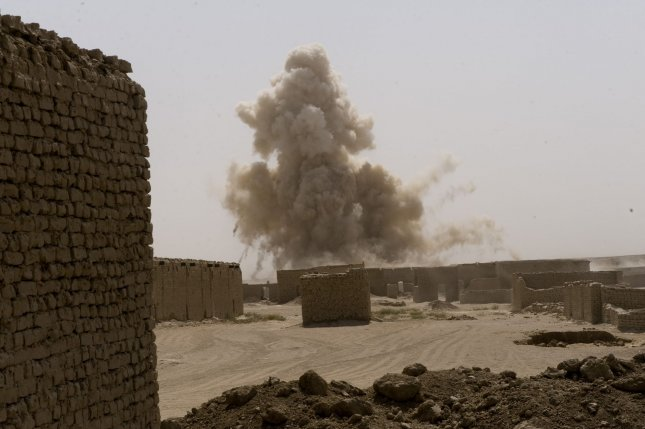 Smoke from a controlled detonation of an IED is see as the U.S. Marines patrol the Safaar Bazar in the Gharmsir District of Helmand province after IEDs where reported in the area in Afghanistan on August 19, 2010. UPI/Hossein Fatemi.