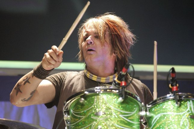 Rikki Rockett performs with Poison on Sept. 1, 2007. The drummer revealed he has oral cancer in an interview Monday. File Photo by Michael Bush/UPI