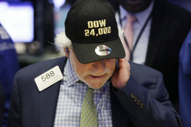 A trader wears a 'Dow 24,000' hat on the floor of the New York Stock Exchange in New York City on Thursday. The Dow Jones Industrial Average surpassed the 24,000 mark for the first time. Photo by John Angelillo/UPI