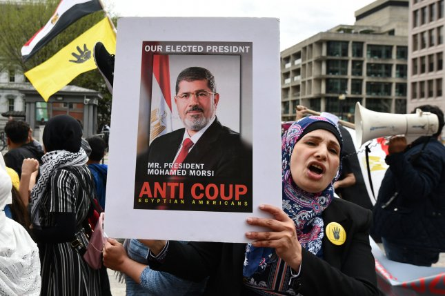 Supporters of former Egyptian President Mohamed Morsi protest in Washington, D.C., where President Abdel Fattah el-Sisi was visiting in April. File Photo by Pat Benic/UPI