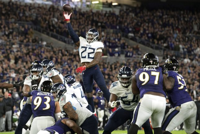 Tennessee Titans running back Derrick Henry (22) threw a three-yard touchdown pass during a win against the Baltimore Ravens Saturday in Baltimore. Photo by Kevin Dietsch/UPI