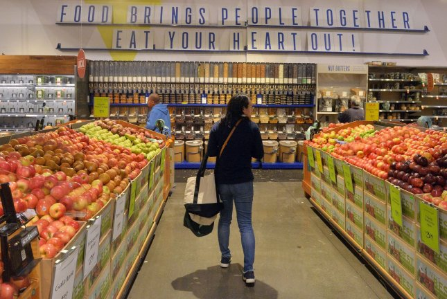 Shoppers stock up on essentials amid the coronavirus pandemic at the Whole Foods Market in downtown Los Angeles on Friday, the same day a federal judge placed a temporary injunction on a Trump administration rule to limit food stamp benefits. Photo by Jim Ruymen/UPI